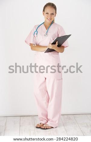 Studio Portrait Of Nurse Against White Background - stock photo