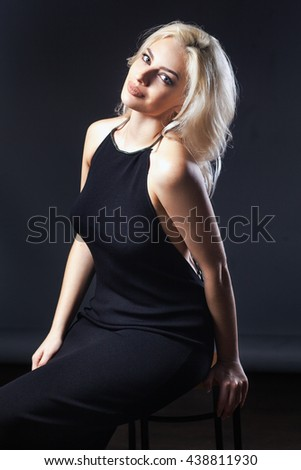 studio portrait of pretty fashionable girl