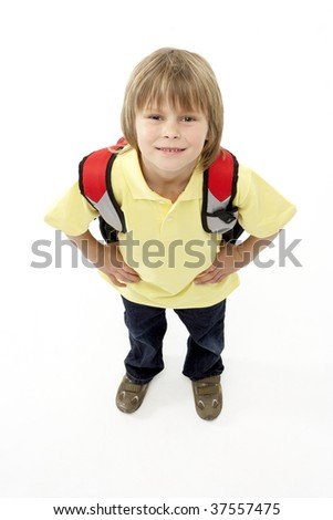 Studio Portrait of Smiling Boy Holding Ruck Sack - stock photo