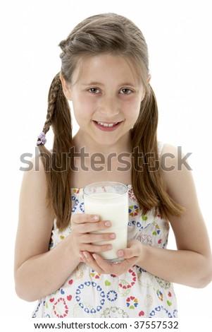 Studio Portrait of Smiling Girl Holding Glass of Milk - stock photo