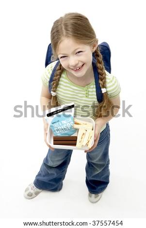 Studio Portrait of Smiling Girl Holding Lunchbox - stock photo