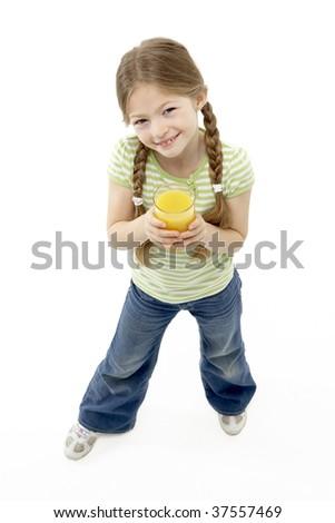 Studio Portrait of Smiling Girl Holding Orange Juice - stock photo