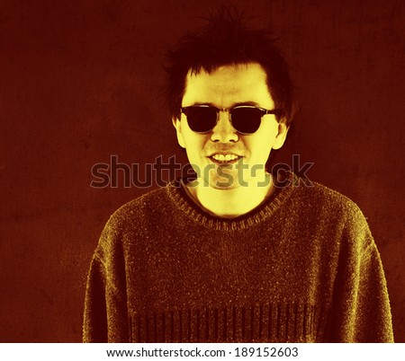 Studio portrait of smiling man in sunglasses.
