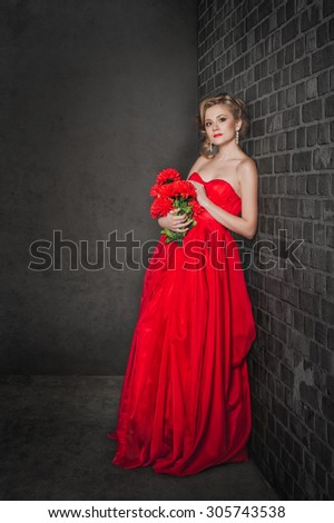 Studio portrait of the girl in a red dress.