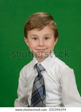Studio portrait of the school boy - stock photo