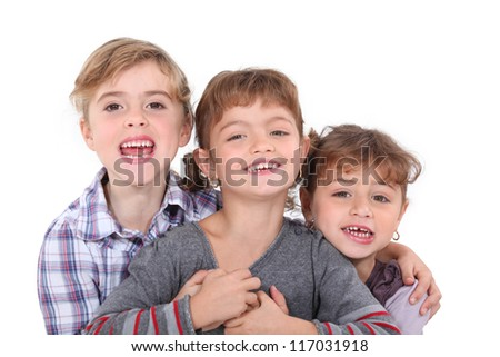 Studio portrait of three young siblings - stock photo