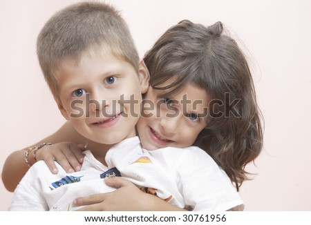 Studio portrait of  two little kids having good time