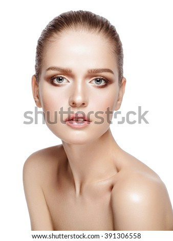 Studio portrait of young attractive model with professional makeup on white background. Perfect skin. Blue eyes. Brunette hairdo. Isolated - stock photo
