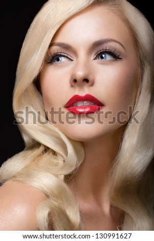 studio portrait of young beautiful blond model