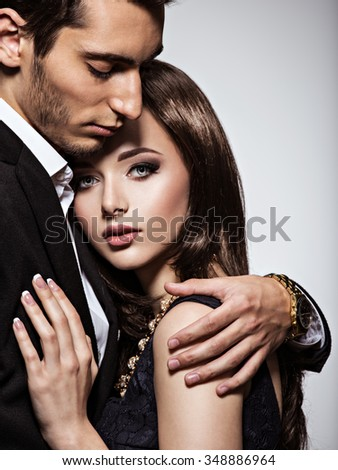 Studio portrait of young beautiful couple in love - stock photo