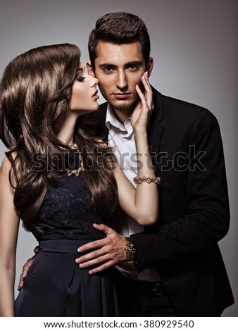 Studio portrait of young beautiful flirting  couple in love