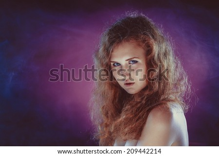 Studio portrait of young beautiful woman - stock photo