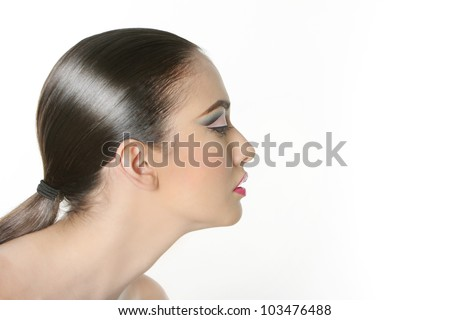 studio portrait of young beautiful woman with bright makeup isolated over white