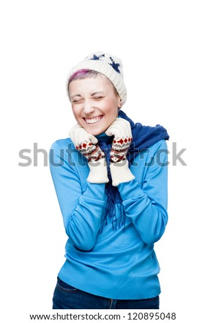 studio portrait of young cheerful blond caucasian girl in winter clothing isolated on white background