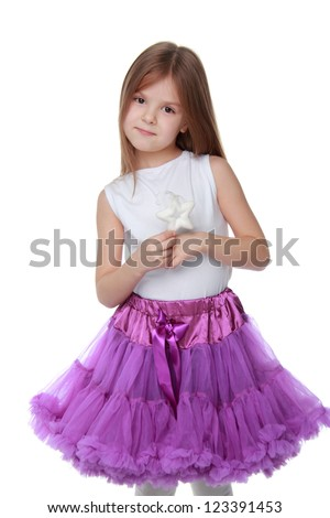 Studio portrait of young girl on Holiday theme isolated on white background