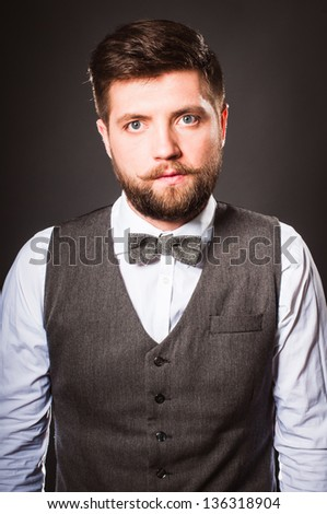 Studio portrait of young man with great beard