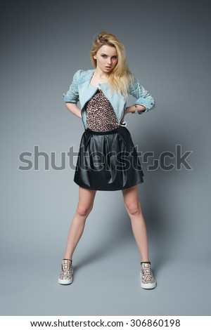 studio portrait of young pretty blonde hipster girl - stock photo