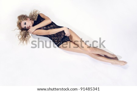 studio portrait of young sexual blond woman - stock photo