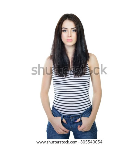 Studio portrait of young woman in blue jeans with long dark hair, over white background. - stock photo