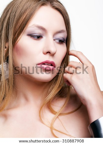 Studio portrait of young woman on white background - stock photo