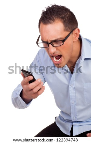 Studio portrait over white of an angry young man yelling into his mobile phone - stock photo