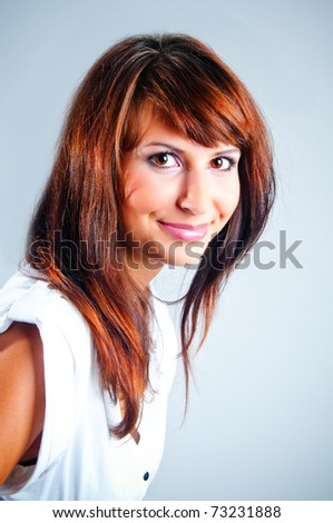 Studio portrait smiling girls on a gray background - stock photo