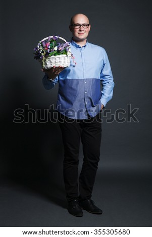Studio portrait with flowers bouquet - valentine's day, dating, fun. Stock image. - stock photo
