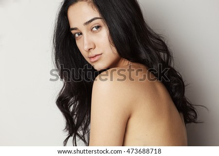 Studio portrait young female model with brunette long hair style opposit white background