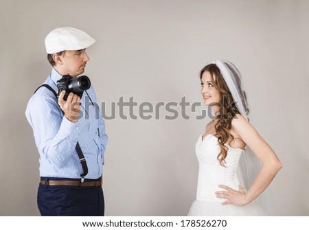Studio portraits with beautiful bride and photographer - stock photo