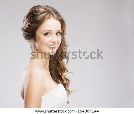 Studio portraits with beautiful woman isolated on gray background