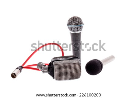 studio recording groups of vintage  microphones for lead vocal on live gig  or for drums ,  music instruments for performance isolated on white background - stock photo