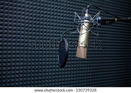 Studio recording microphone near wall with acoustic dampening foam