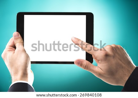 Studio shoot of a hand touching a tablet