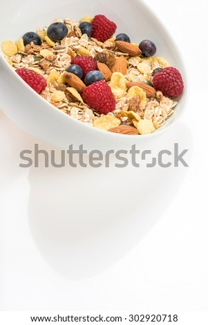studio shoot of flakes, cereal, almond, dry fruit, seeds, fresh fruit on white background