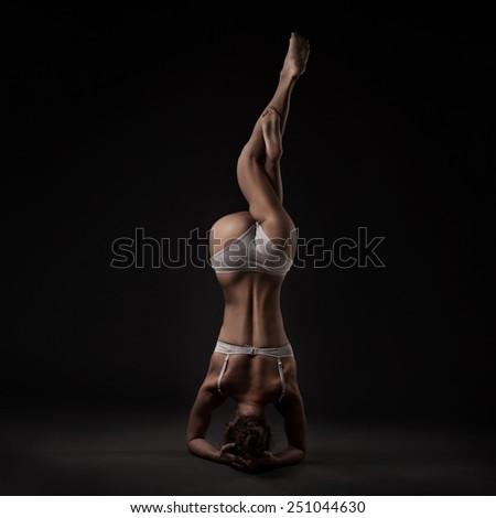 studio shoot of healthy latino woman doing yoga isolated  - stock photo