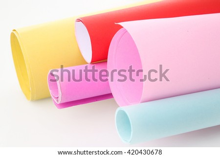 Studio shoot of rolls of colored paper