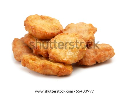 Studio shooting of a fried chicken pieces (mcnuggets) on white background