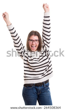 Studio shot: Happy woman with raised arms - stock photo