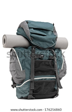 Studio shot of a backpack with exercising mat isolated on white background - stock photo