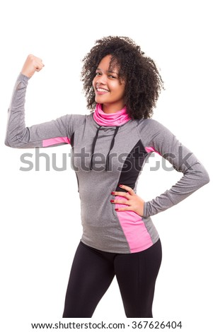 Studio shot of a beautiful african woman exercising - stock photo