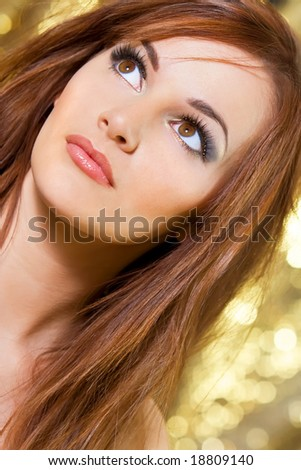 Studio shot of a beautiful young brunette woman with striking brown eyes - stock photo