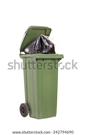 Studio shot of a big green trash can isolated on white background - stock photo