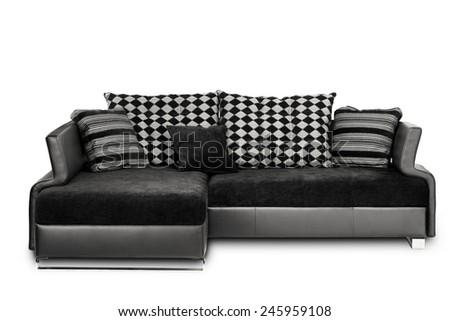Studio shot of a black angle sofa on white background - stock photo
