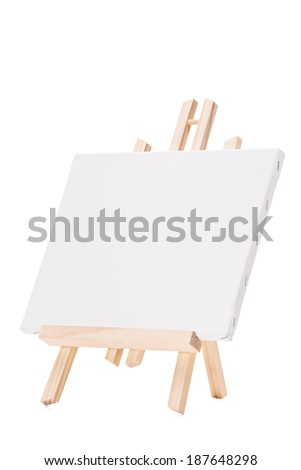 Studio shot of a blank canvas on an easel isolated on white background