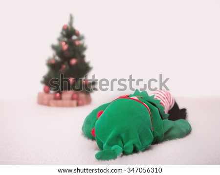 Studio shot of a boy dressed as an elf - stock photo