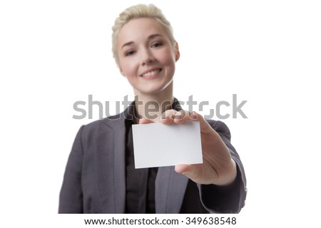 Studio shot of a business woman holding a small white blank card - stock photo