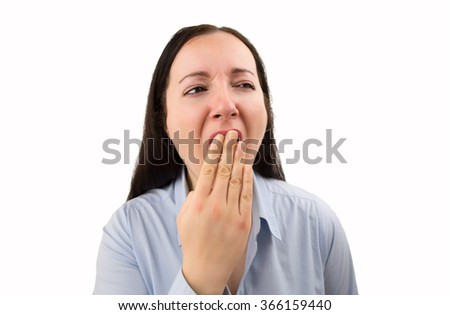Studio shot of a business woman yawning isolated on a white background - stock photo