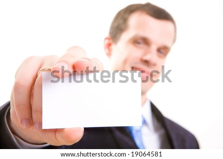 Studio shot of a businessman holding out a blank business card. Room for text, or your own message.