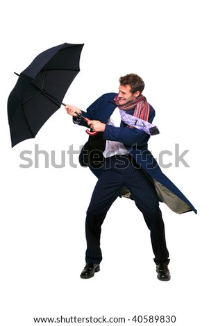 Studio shot of a businessman struggling with an umbrella in the wind, isolated on a white background.