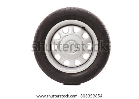 Studio shot of a car tire isolated on white background - stock photo
